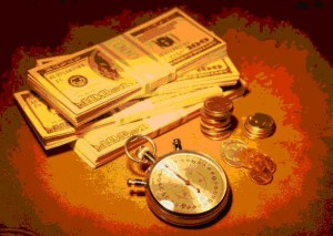 Image of money and time piece, copyright Microsoft.