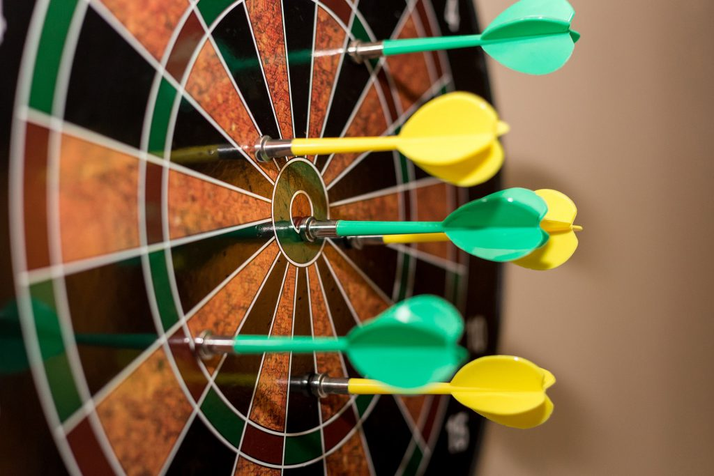 An image of a target with darts sticking in it